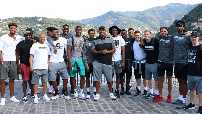 2_coach_cooley_with_the_guys_and_lake_como.jpg?preset=large